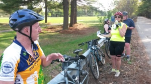 Larry finison points out features on a previous History ride